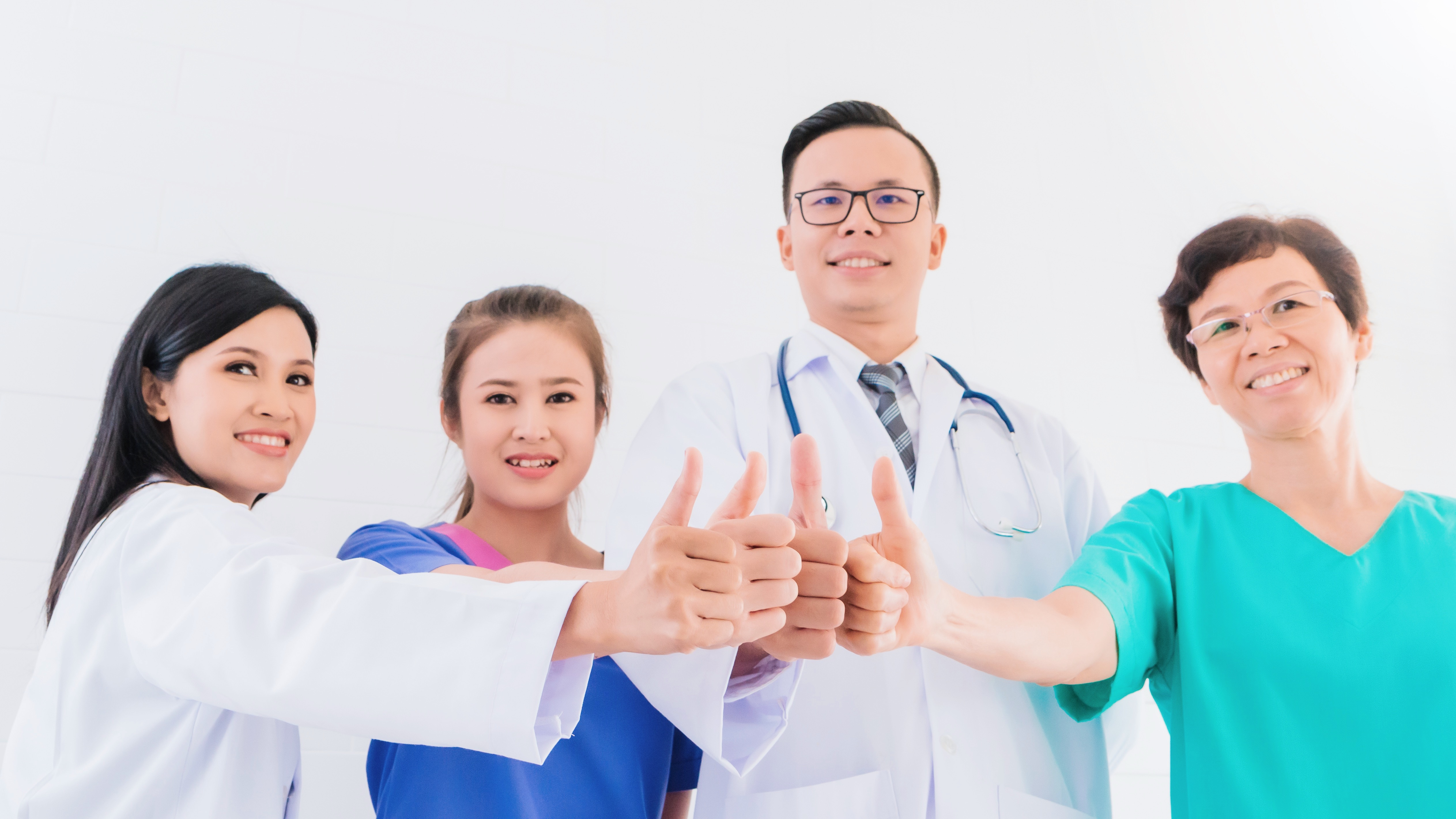 portrait-smiling-asian-medical-male-doctor-standing-showing-hand-thumb-up-with-team-staff-hospital.jpg